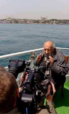 Ara Guler on the boat with cameraman